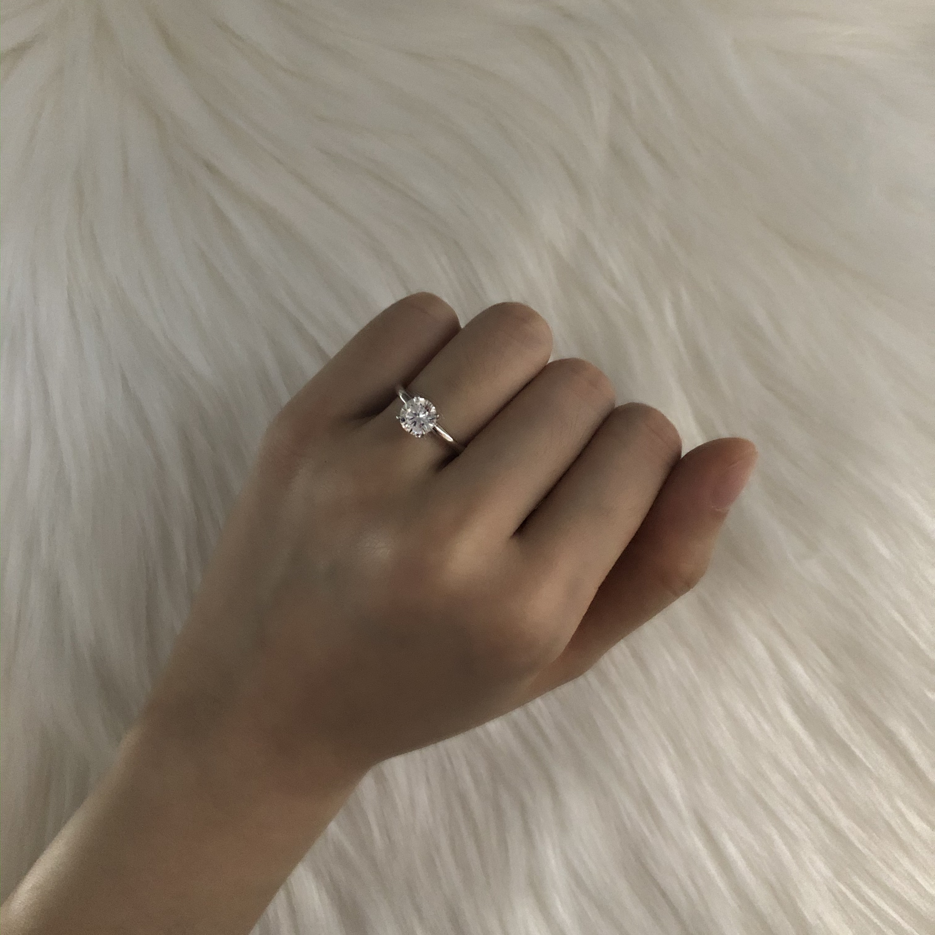 taking engagement ring photo in a dim room