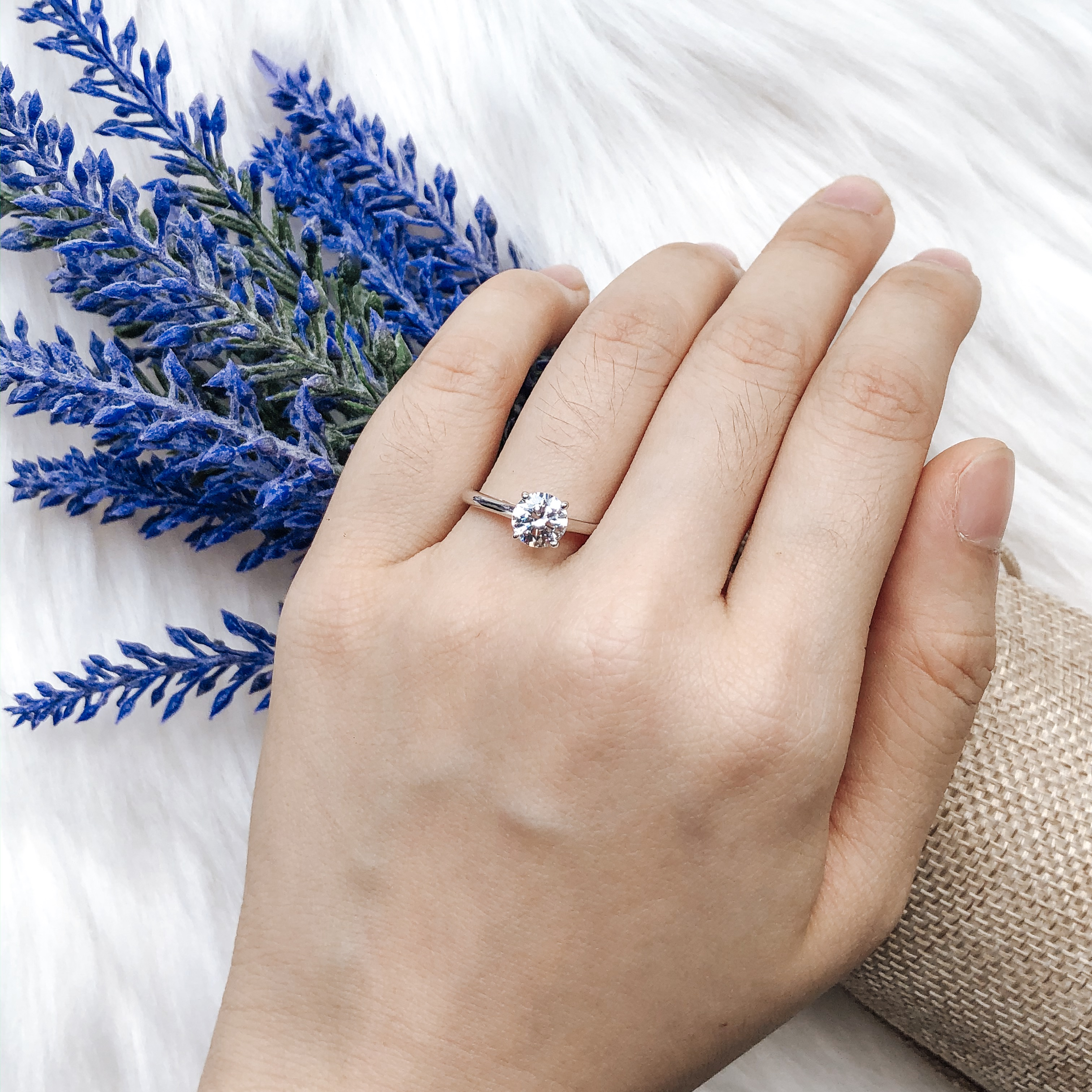 taking proposal ring with flowers