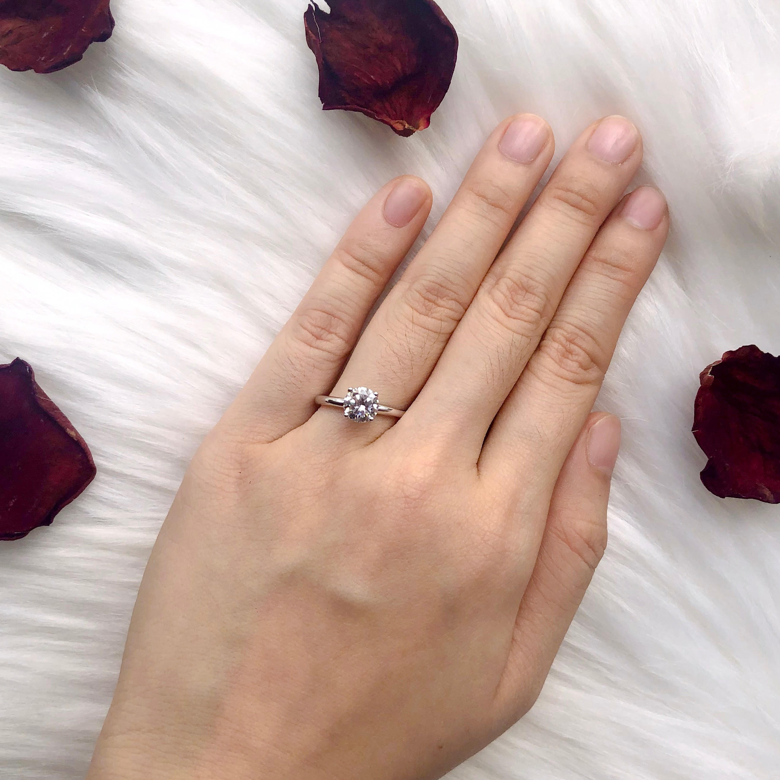 taking photo of engagement ring with rose background