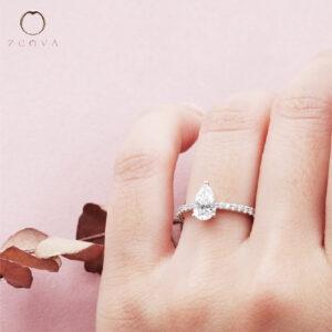 Pear Cut Diamond Engagement Ring on Hand