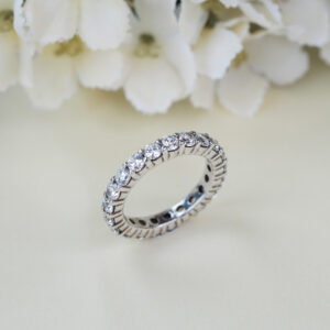 Shared prong pave engagement ring