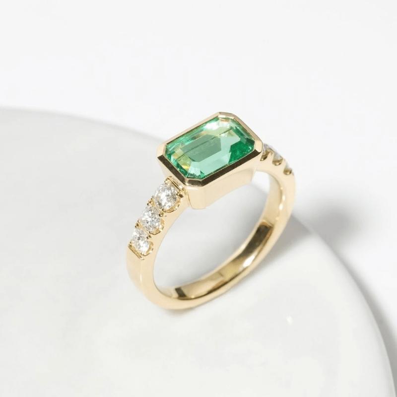 Customized Ring With Emerald Gemstone & Side Diamonds