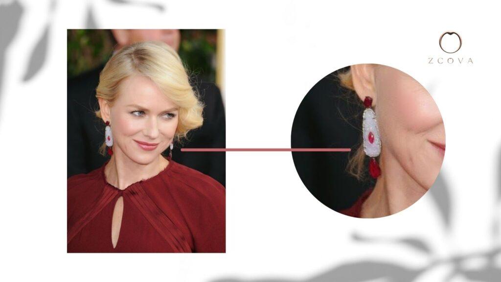 Naomi Watts wearing a diamond and ruby gemstone earring
