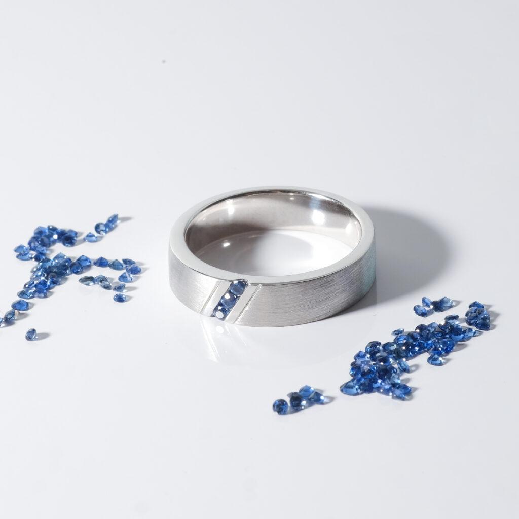 three stone blue sapphire matte wedding band
