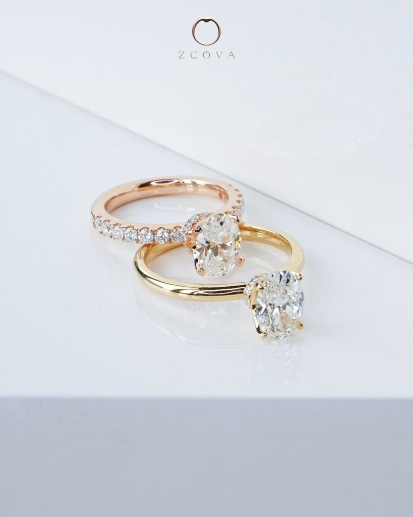 Oval diamond engagement ring yellow gold and rose gold
