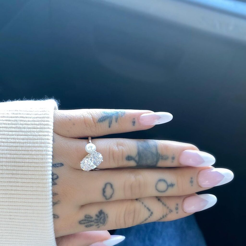 Ariana Grande's 5CT oval diamond and pearl Engagement Ring