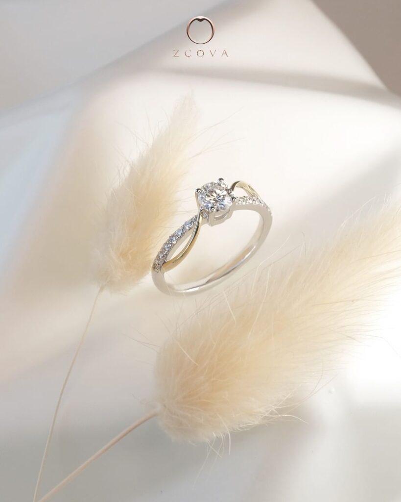 Mixed metal two tone diamond engagement ring